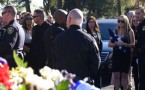 Solemn goodbye to Riverside officer Michael Crain